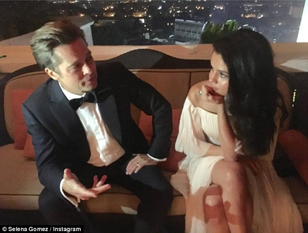 Not happy: Angelina Jolie was reportedly furious when Selena Gomez posted this flirty Instagram at the Golden Globes with Brad Pitt back in January