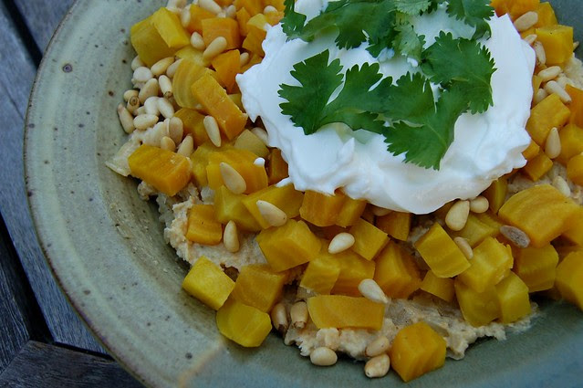 Hummous with caramelized onions & garlic topped with golden beets, pinenuts and greek yogurt