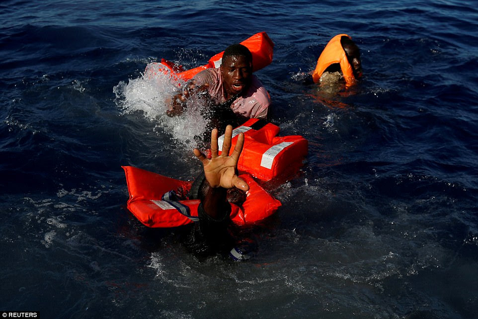 Migrants try to stay afloat after falling off their rubber dinghy during a rescue operation by Malta-based Migrant Offshore Aid Station (MOAS). The NGO's ship was in the central Mediterranean in international waters some 15 nautical miles off the coast of Zawiya, Libya, on April 14. All 134 of the sub-Saharan migrants survived after being rescued by MOAS