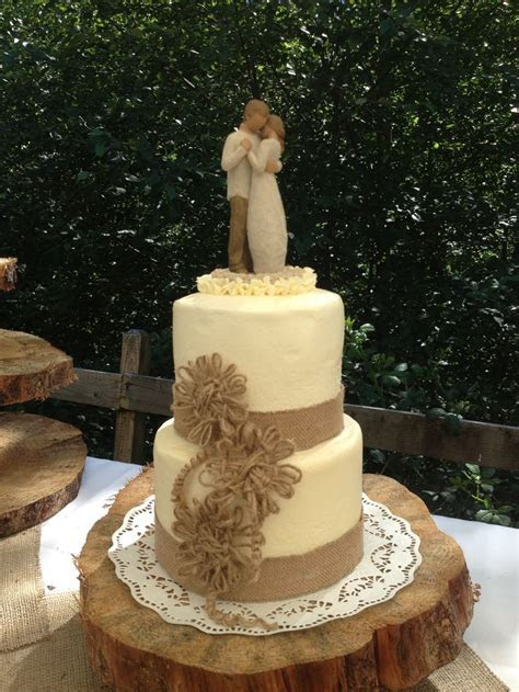 Rustic Elegance. Wedding cake with burlap lace and twine