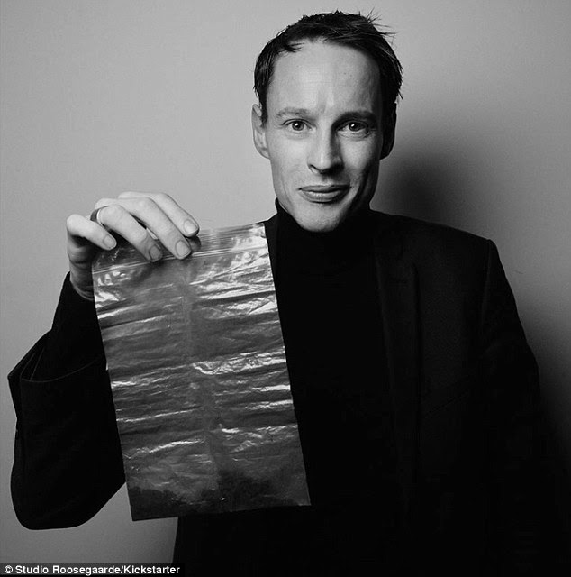 The machine will harvest smog (pictured being held by designer Daan Roosegaarde) which will be used to make quirky jewellery, because the 'smog cubes' will be incorporated into the design