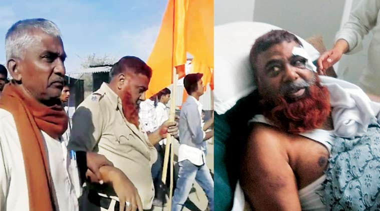 ASI Yunus Sheikh being paraded with the saffron flag; admitted to a hospital in Latur, Maharashtra.