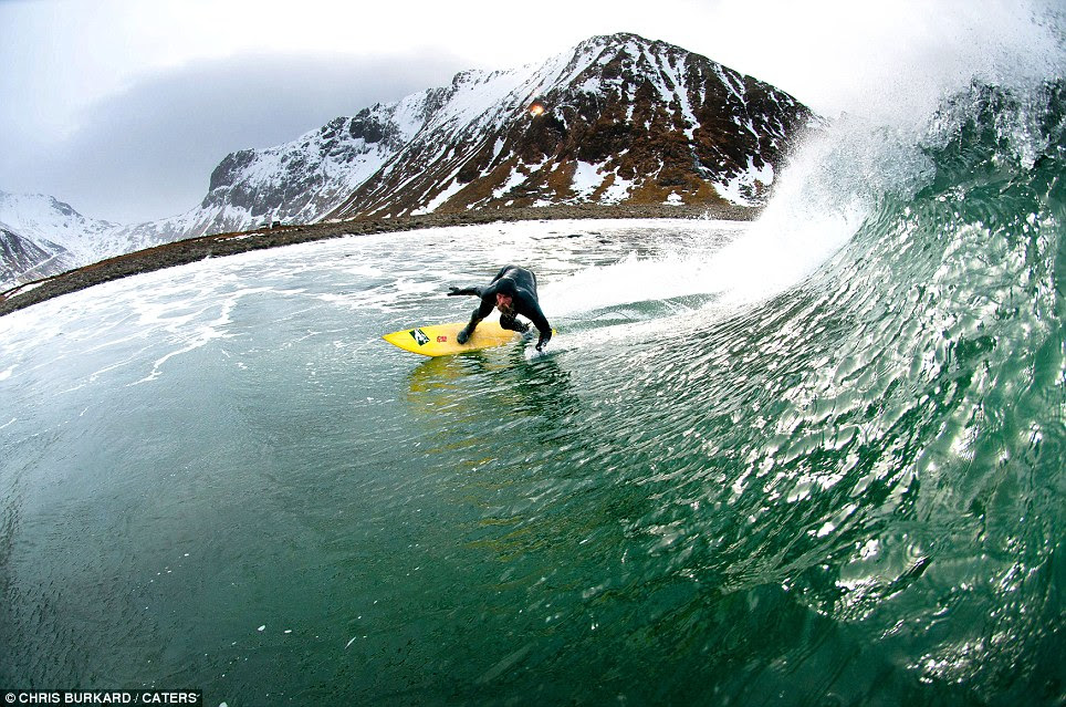 Surfer Keith Malloy carves up an icy wave in the Arctic, where the water temperature is as low as 2C. He's more used to the golden beaches of California