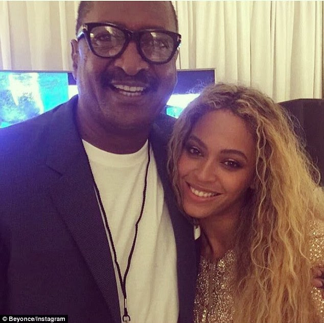 Father daughter time:She posted another photo soon after of just her and her dad hugging as they both smile for the camera