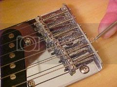 A standard Telecaster style bridge allows a great degree of change in intonation.
