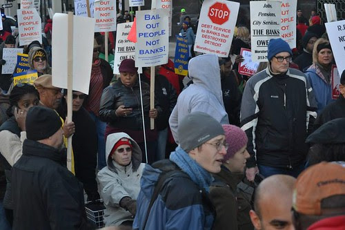 Members of labor unions and community organizations demanding the end to attacks on pensions, healthcare and city assets in Detroit. People protested the bankruptcy proceedings. by Pan-African News Wire File Photos