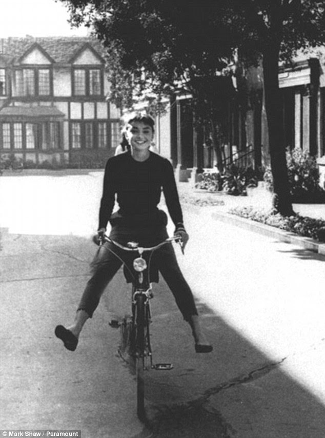 A true star: Kim appeared to be channeling Audrey with her bike and black outfit