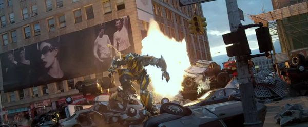 Bumblebee dodges an explosion in TRANSFORMERS: AGE OF EXTINCTION.