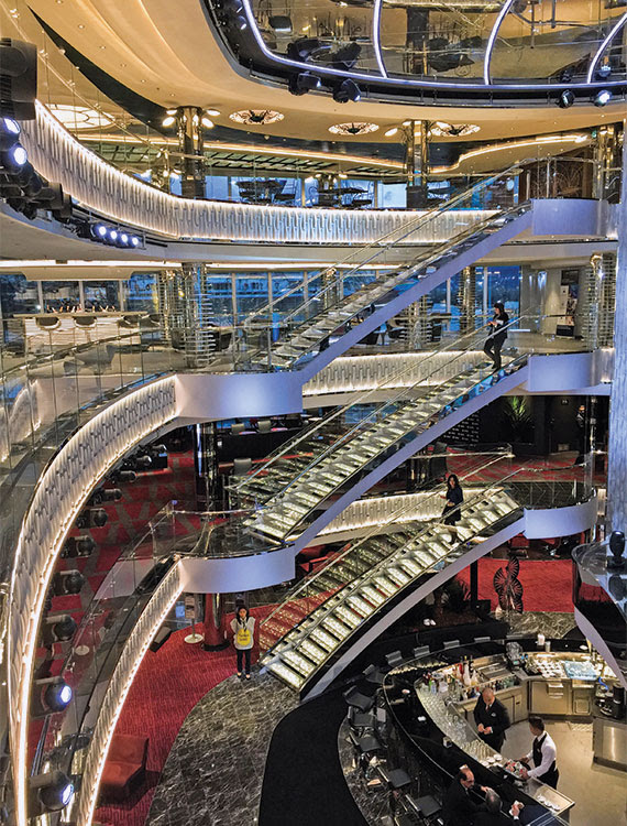 The four-story atrium features stairs with transparent steps embedded with Swarovski crystals and tiny lights. Photo Credit: Tom Stieghorst