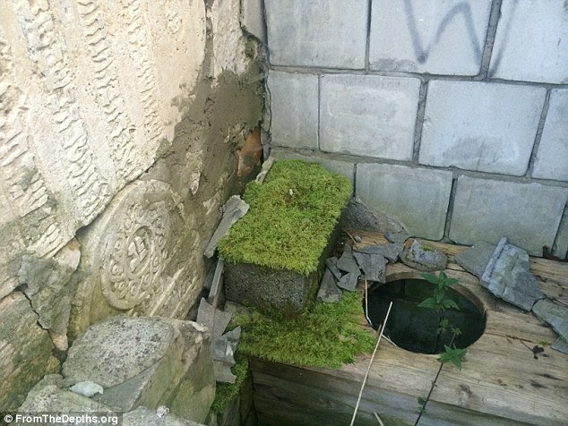 Violated:Poland-based charity, Matzeva, which preserves Jewish heritage in Poland, has found Jewish tombstones being used as paving slabs and to build a cowshed and an outside toilet (pictured) in the country