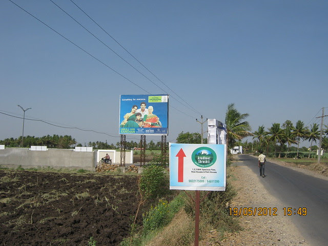 Site Hoarding on the Road to Uruli Kanchan Railway Station - Visit Kanchan Vrundavan, 1 BHK & 2 BHK Flats at Koregaon Mul, near Uruli Kanchan Pune 412202