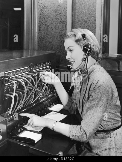 http://l7.alamy.com/zooms/47a0204fa93043ea9245bb9b821bae6f/telephone-operator-working-at-switchboard-d1832g.jpg