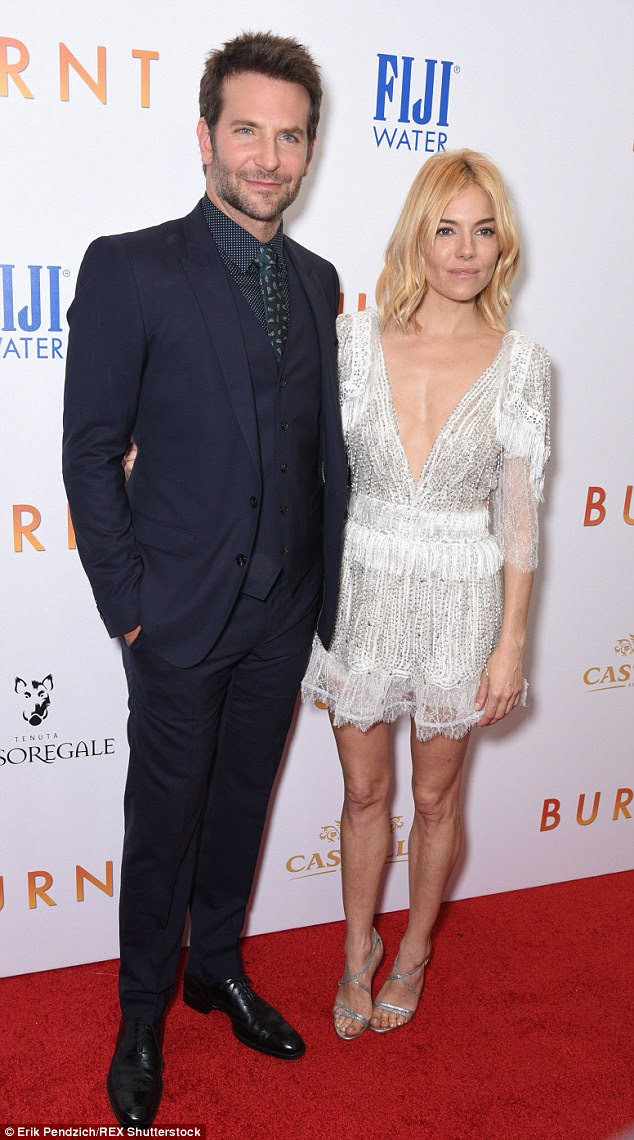 Sienna Miller dips it low in intricate deep plunging white mini-dress as she cosies up to handsome co-star Bradley Cooper at Burnt premiere