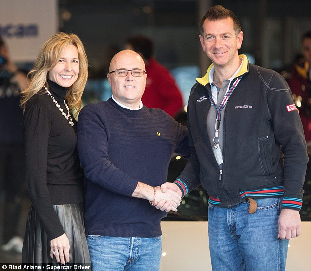 'Amazing': Paul Bailey (centre) and his wife Selena on the day he picked up his Porsche 918 from the dealer