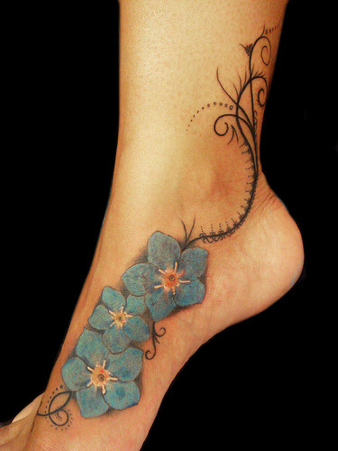 Forget Me Not Flower Tattoo On The Leg