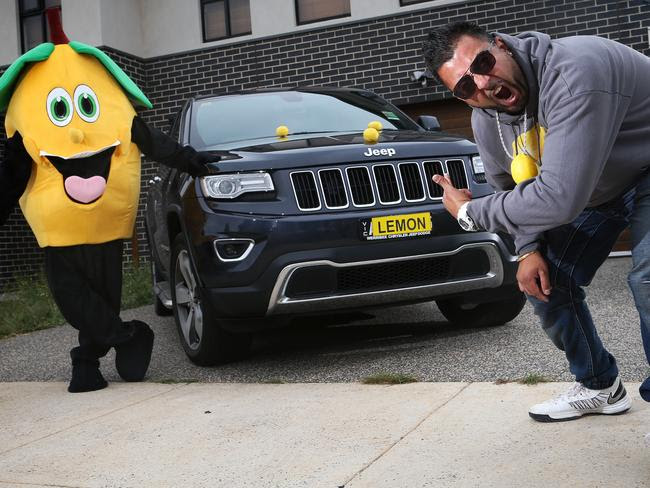Making a statement ... Teg Sethi with his brother Geetraj Singh Sethi (dressed as a lemon) with Teg's Jeep which was the inspiration for a YouTube video. Picture: Hamish Blair