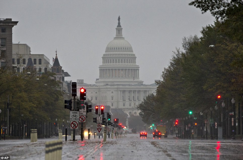 Elsewhere: The U.S. Capitol Building and Pennsylvania Avenue are seen on Monday morning, as heavy rain from Hurricane Sandy arrives in Washington D.C.