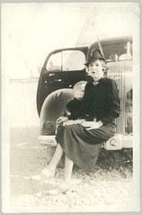 Woman on Car Bumper