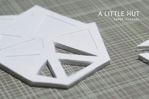 paper pendant - cutting by hand