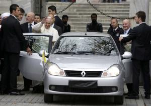 Pope Francis waves to journalists as he leaves the…