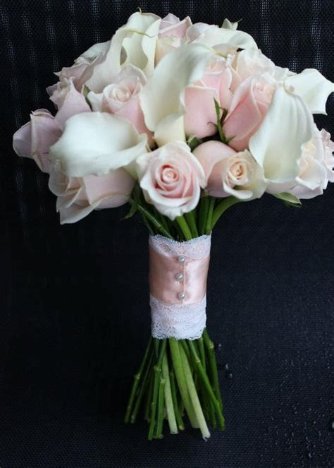 roses and calla lilies wedding bouquet lace handle details