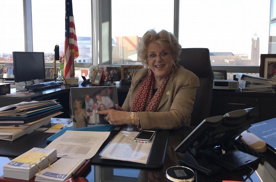 Carolyn Goodman, the mayor of Las Vegas, poses with a photo of her family in her office, Feb. 10, 2016. (Ron Kampeas)