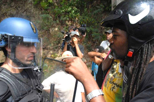 France sent hundreds of gendarmes – police – replete with riot gear to Guadeloupe to put down a month-long general strike demanding higher wages and lower prices but, despite the death of one of their leaders, the Guadeloupean people won't back down. Like Haiti, the Caribbean islands of Guadeloupe and Martinique, also gripped by a general strike, are populated by the descendants of enslaved Africans and were colonized by France. Haitians revolted, defeating Napoleon's armies in 1804, becoming the first Black independent country in the world. Guadeloupe and Martinique remain colonies. Though racism keeps all three islands dirt poor, it's apparent in this confrontation that the people of Guadeloupe have plenty of pride and courage. - Photo: LKP