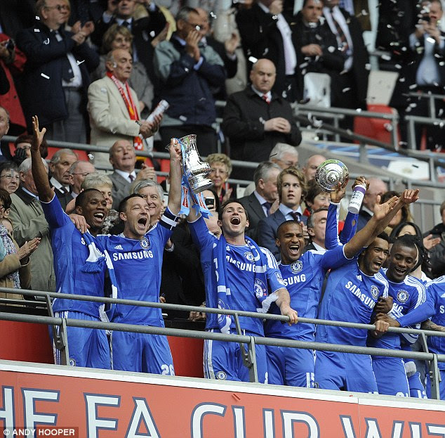 Successful: John Terry and Lampard lift the FA Cup trophy in 2012 after beating Liverpool at Wembley