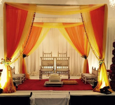 Red & Gold Fabric Mandap with Marigold Flowers by Aayojan