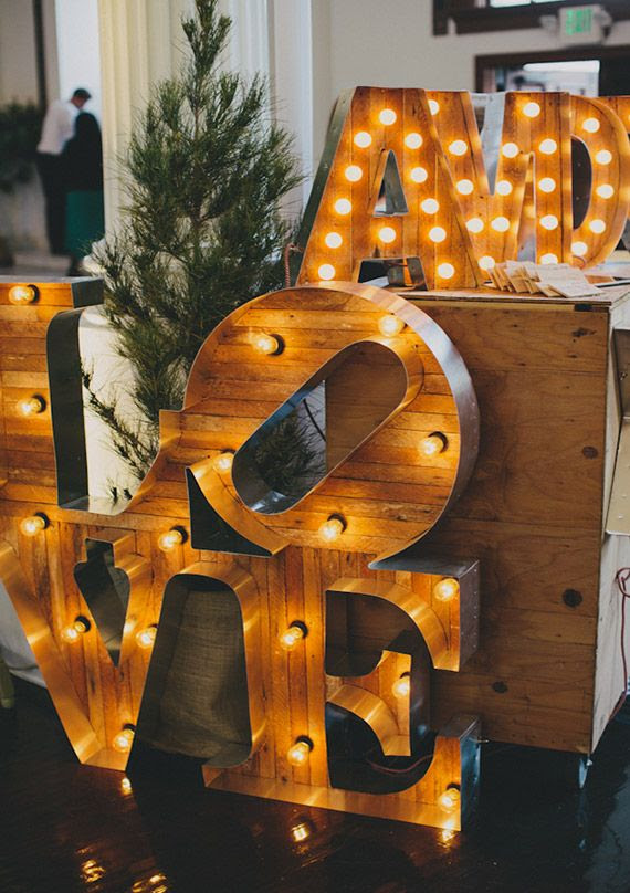 Fun typography signs add a bit of glitz to a wedding reception.