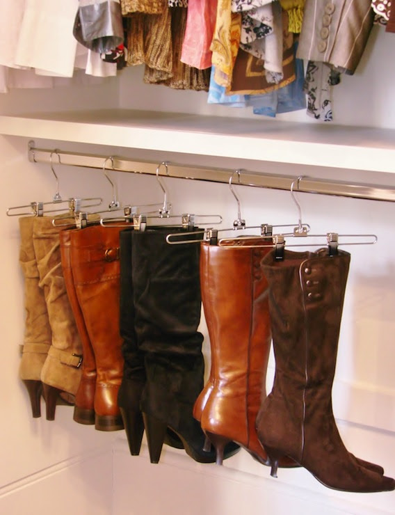 closet with Target hangers used to display boots storage idea for shoes