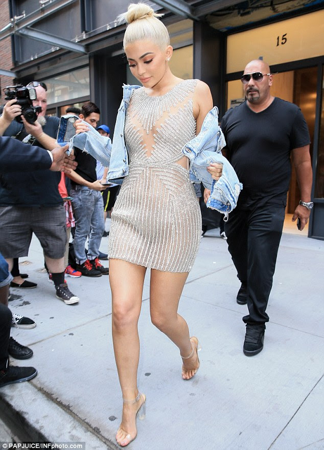 Leaving little to the imagination: The 19-year-old was clad in a shimmering silver mini-dress