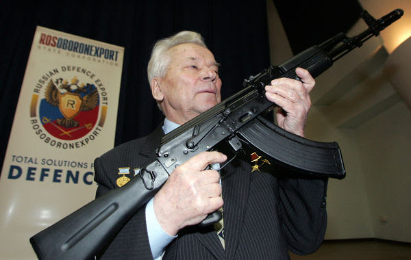 Mikhail Kalashnikov with a more modern AK-74 (easily identified by the grove on the butt stock)