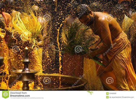 Hindu Devotees Perform The Turmeric Bathing Ritual During