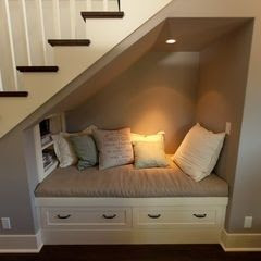 Why waste a perfectly good space by closing it off with a wall? This space makes a great reading nook!