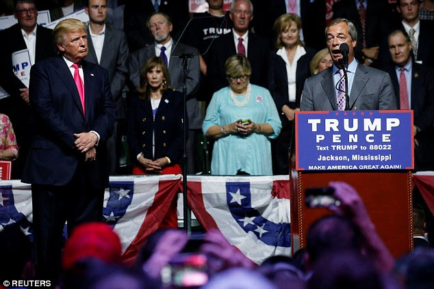 Farage, right, told the crowd that he would never vote for a candidate like Hillary Clinton