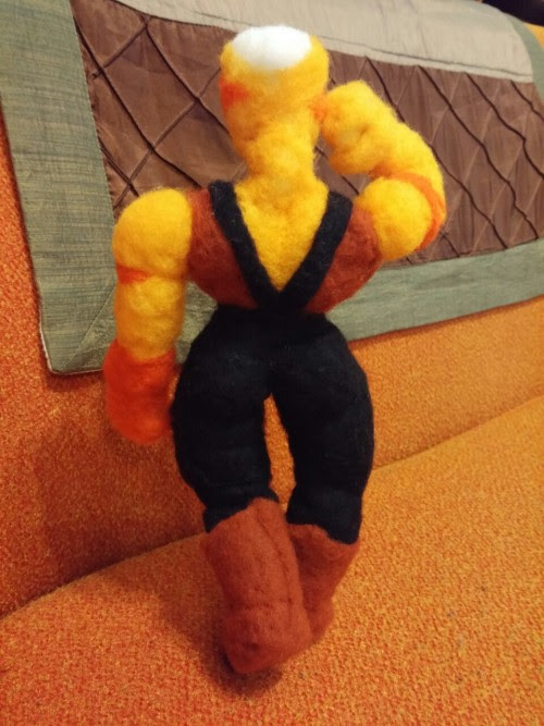 Welcome to the gun show!     As long as I'm playing around with different styles, I figured I'd try felting some muscles instead of my usual noodle arms. And who better for that than a big, buff cheeto puff?      I realised something while working on this one. Steven Universe does a lot of work to associate strength with femininity. The small, physically weaker gems on the show (the real definition of 'strength' is another topic the show goes into great detail on, but that's for a different discussion) tend to have short hair and flat chests. The quartz soldiers, on the other hand, are big and imposing, but they're also the ones that have hourglass figures, long hair and thick eyelashes, all traditional signifiers of femininity. Rose and Jasper, the two strongest gems we've seen, even have pink hair! It's neat.     I also noticed that she wears Dragonball Z boots, but that's not as interesting.     Bonus pics before I put the hair on. Give people one last glimpse of that ol' LHB.     More felties: Undertale | Steven Universe | Gravity Falls | Rick and Morty | Everything else