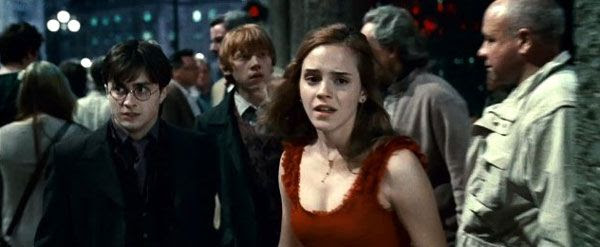 Harry Potter, Hermione Granger and Ron Weasley attempt to elude Lord Voldemort's minions in Part 1 of HARRY POTTER AND THE DEATHLY HALLOWS.