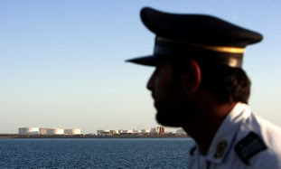 Iranian officer looks at Strait of Hormuz
