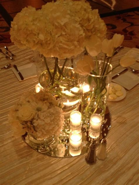 Modern romantic centerpieces All white centered on mirrors