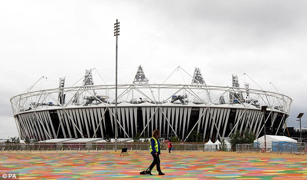 Threat: Staff prepare for the Games at the Olympic Park as three terror suspects were arrested just a mile away