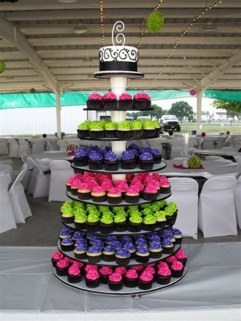 Hot pink, lime green, and purple wedding cupcake tower