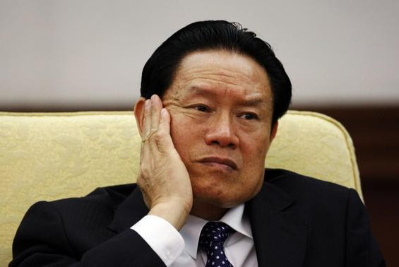 China's Public Security Minister Zhou Yongkang reacts as he attends the Hebei delegation discussion sessions at the 17th National Congress of the Communist Party of China at the Great Hall of the People, in Beijing in this October 16, 2007 file photo. REUTERS-Jason Lee-Files