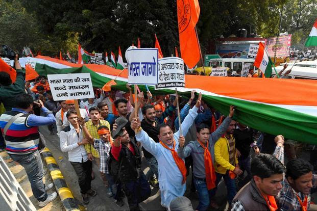 Students of the Akhil Bharatiya Vidyarthi Parishad shout slogans during a march from Ramlila Ground to Jantar Mantar over the JNU issue in New Delhi on Wednesday. Photo: PTI