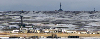 Gas drilling rigs in western Wyoming's Upper Green River Basin. (AP Photo/Mead Gruver)