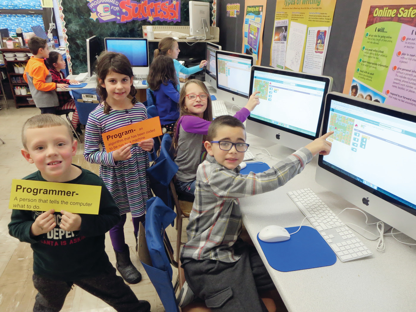 Elementary school students learn computer science skills ...