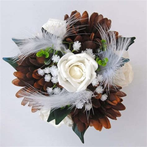 White feathers Brown Gerbera & White Roses in a Bouquet