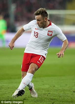 Poland's World Cup strips feature a diagonal line going down the front of the shirt