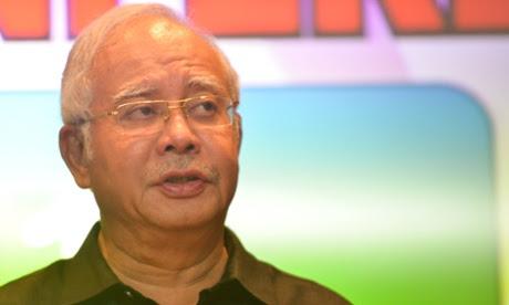 Malaysian Prime Minister Najib Razak attends a press conference at a hotel at the Kuala Lumpur International Airport.