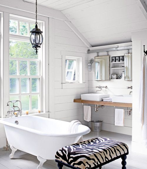 Smart! These bathroom mirrors slide open, barn door-style, to reveal a recessed medicine chest.